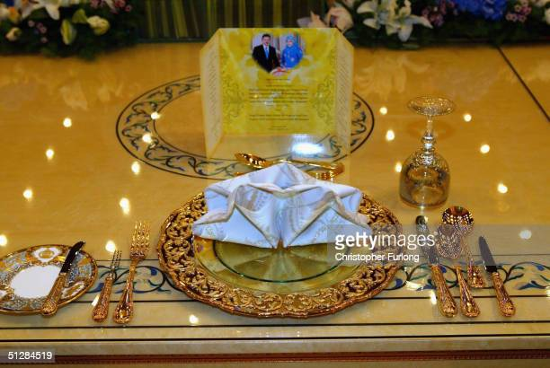 Elaborate gold place settings for the Prince and Princess at the Persantapan Pengantin Diraja following the wedding of His Royal Highness Prince Haji...