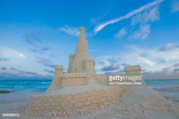 Elaborate sand castle on beach