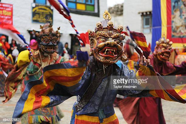 Elaborately dressed monks costumed as wrathful guardian spirits perform ceremonial dances during the Tenchi Festival on May 25, 2014 in Lo Manthang,...