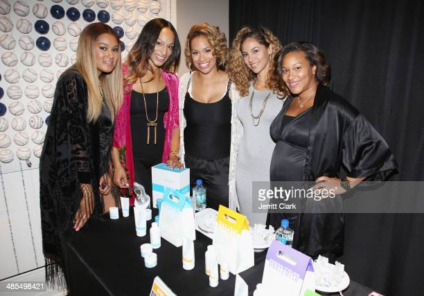 Elaina Watley Alexis Stoudemire and Amber Sabathia pose with reps from Rodan Fields during Ladies Night In Benefiting Not For Sale on April 17 2014...