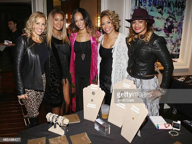 Elaina Watley Alexis Stoudemire and Amber Sabathia pose with reps from Honesty Jewelry during Ladies Night In Benefiting Not For Sale on April 17...