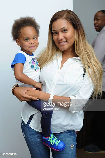 Elaina Watley and daughter Kennedy Cruz pose for a photo backstage at the Nike/Levi Kids fashoin show during MercedesBenz Fashion Week Spring 2015 at...