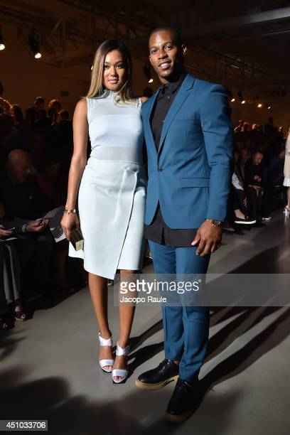 Elaina Watley and Victor Cruz attend Calvin Klein Collection during Milan Fashion Week Menswear Spring/Summer 2015 on June 22 2014 in Milan Italy