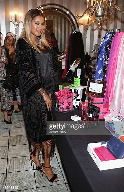 Elaina Watley poses with her pick at Saks boutique at Ladies Night In Benefiting Not For Sale on April 17 2014 in Alpine New Jersey