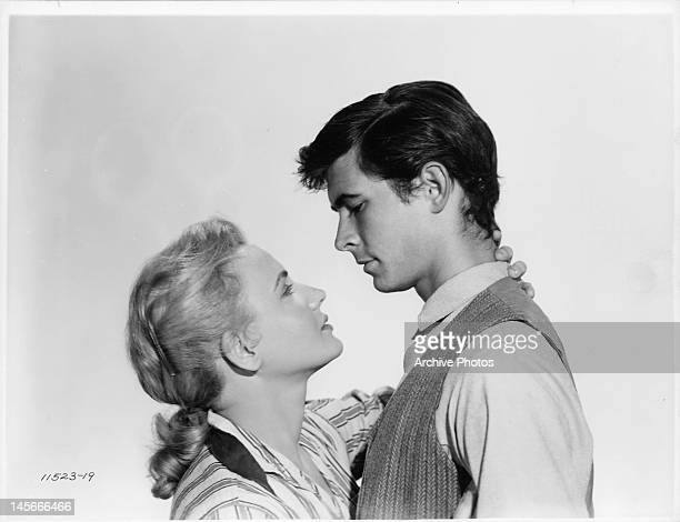 Elaine Aiken and Anthony Perkins embracing in a scene from the film 'The Lonely Man' 1957