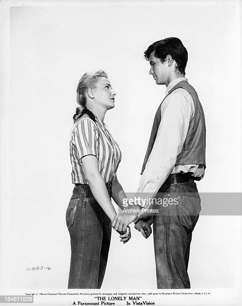 Elaine Aiken looking up at Anthony Perkins in publicity portrait for the film 'The Lonely Man' 1957