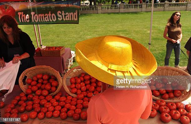 Elaine Asarch looks over a choice selection of tomatoes at the Tomato Stand The Tomato Stand offers beefsteak tomatillas vineripened grape cherry...