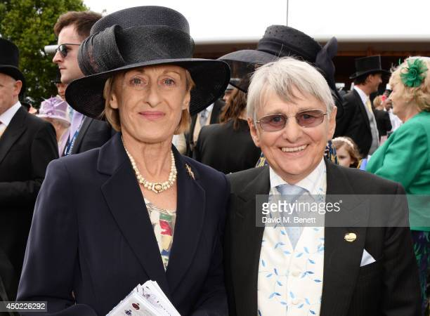 Elaine Carson and Willie Carson attend Derby Day at the Investec Derby Festival at Epsom Downs Racecourse on June 6 2014 in Epsom England