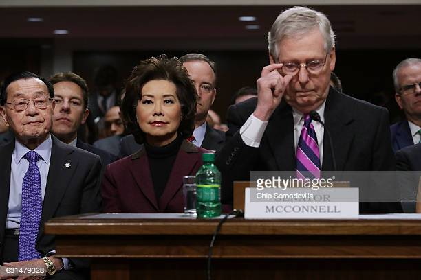 Elaine Chao listens to her husband Senate Majority Leader Mitch McConnell during her confirmation hearing to be the next US secretary of...