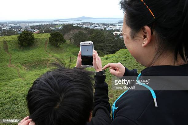 Elaine Chung says Pokemon Go is a great way to bond with her son Samuel as they search on the summit of Mount Eden on July 13 2016 in Auckland New...