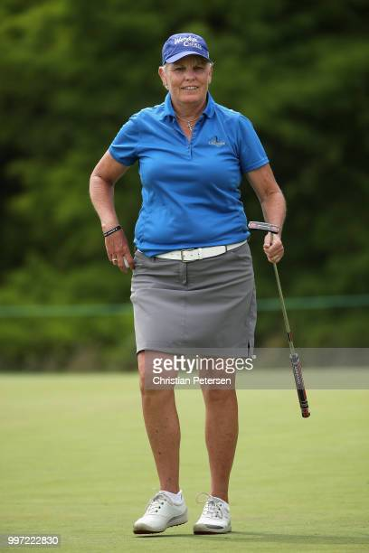 Elaine Crosby reacts to her putt on the 18th green during the first round of the US Senior Women's Open at Chicago Golf Club on July 12 2018 in...