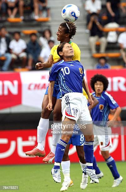 Elaine Estrela Moura of Brazil battles for the ball against Homare Sawa of Japan during the women's international friendly match between Japan and...