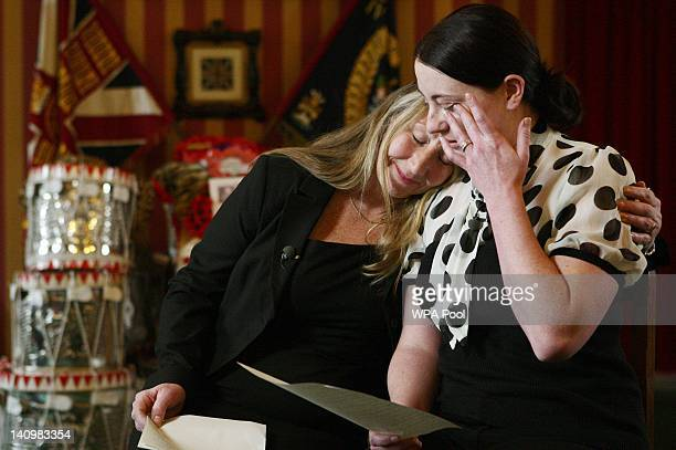 Elaine Freeman mother of Sergeant Nigel Coupe of 1st Battalion The Duke of Lancaster's Regiment hugs her daughter in law Natalie Coupe as she wipes a...