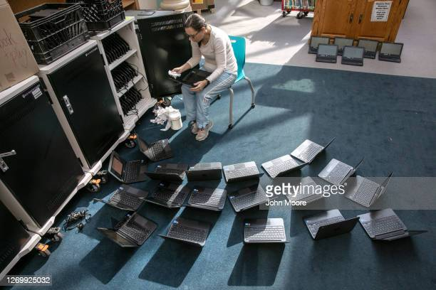 Elaine Jencarelli technical integration support specialist cleans Chromebooks while preparing for the Sept 8 start of school at Newfield Elementary...