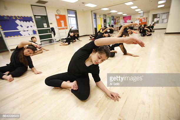 Elaine Martinez center a sixth grade student at Gabriella Charter School stretches during dance class on a campus that Gabriella shares with Logan...
