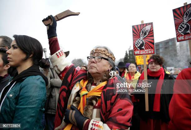 Elaine McCloud of the Chehalis Tribe in Washington state shows her support at Women's March 20 one year after people worldwide marched for women's...