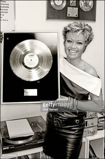 Elaine Page poses with a gold disc London 1985