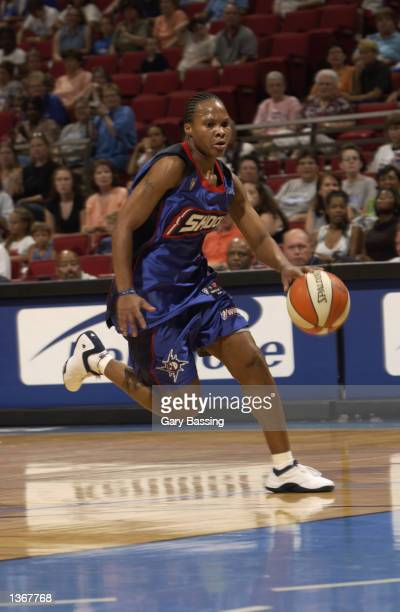 Elaine Powell of the Detroit Shock drives to the basket during the game against the Orlando Miracle on August 11 2002 at TD Waterhouse Centre in...