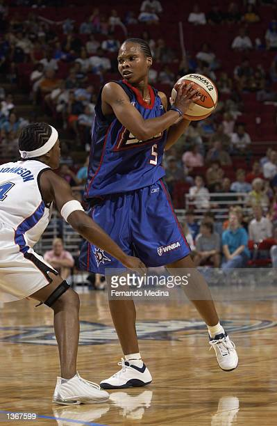 Elaine Powell of the Detroit Shock is defended by Shannon Johnson of the Orlando Miracle during the game on August 11 2002 at TD Waterhouse Centre in...