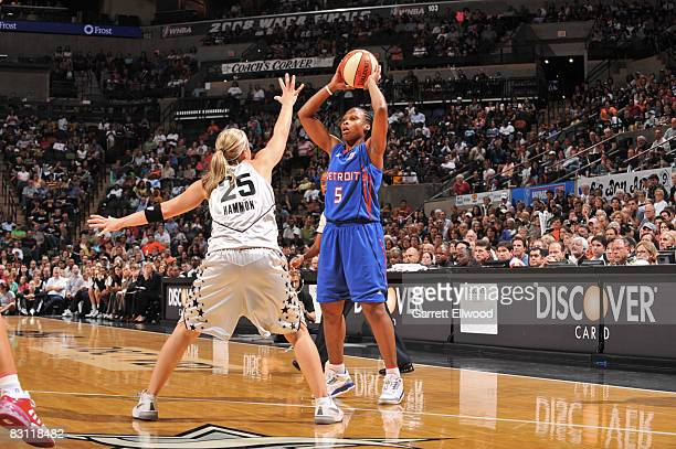Elaine Powell of the Detroit Shock passes against Becky Hammon of the San Antonio Silver Stars in Game Two of the WNBA Finals on October 3 2008 at...
