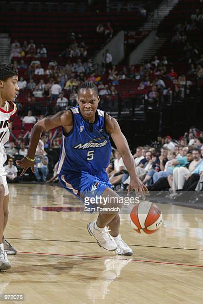 Elaine Powell of the Orlando Miracle drives from the outside during the game against the Portland Fire on June 26 2002 at the Rose Garden in Portland...
