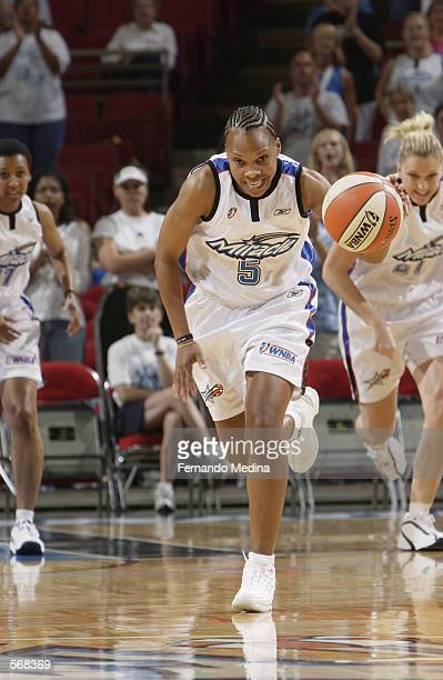 Elaine Powell of the Orlando Miracle drives upcourt during the preseason game against the Miami Sol at TD Waterhouse Centre in Orlando Florida on May...
