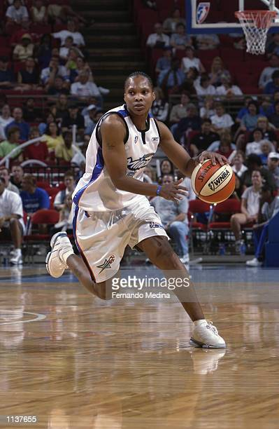 Elaine Powell of the Orlando Miracle drives upcourt in the game against the Indiana Fever on July 3 2002 at TD Waterhouse Centre in Orlando Florida...