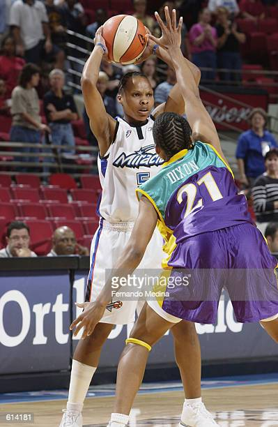 Elaine Powell of the Orlando Miracle faces up Tamecka Dixon of the Los Angeles Sparks during the WNBA game at TD Waterhouse Centre in Orlando Florida...