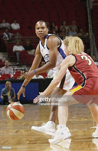 Elaine Powell of the Orlando Miracle looks to pass around Debbie Black of the Miami Sol during the preseason game at TD Waterhouse Centre in Orlando...