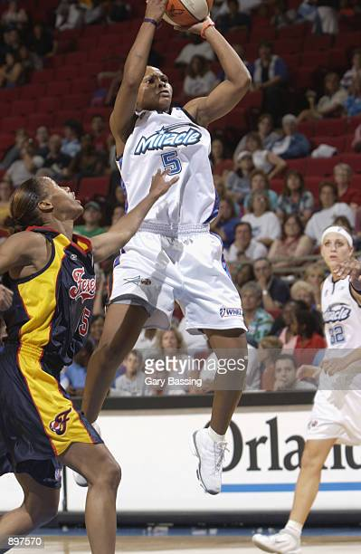 Elaine Powell of the Orlando Miracle puts up a shot over Nikki McCray of the Indiana Fever in the game on June 11 2002 at TD Waterhouse Centre in...