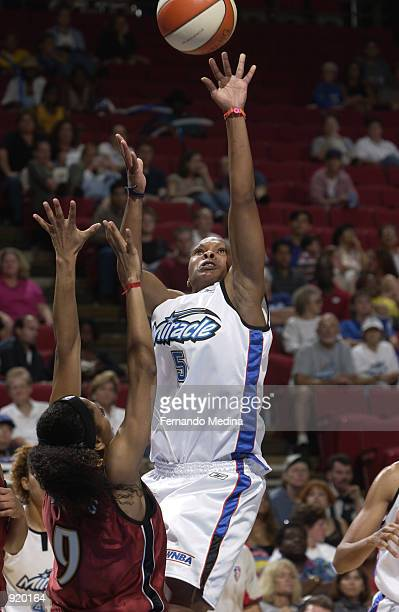 Elaine Powell of the Orlando Miracle shoots over Claudia Neves of the Miami Sol in the game on June 15 2002 at TD Waterhouse Centre in Orlando...