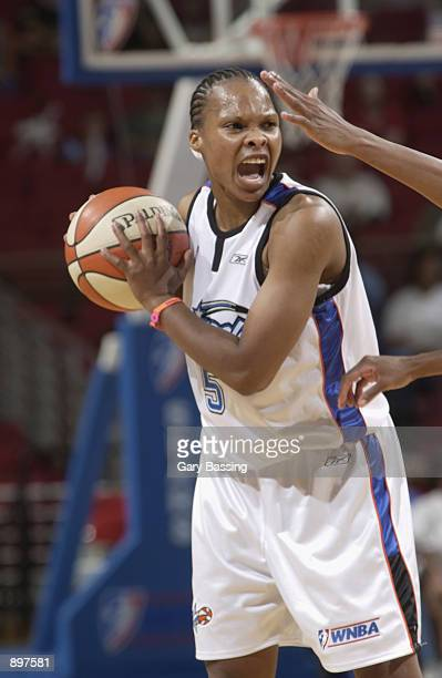 Elaine Powll of the Orlando Miracle yells in the game against the Indiana Fever on June 11 2002 at TD Waterhouse Centre in Orlando Florida The Fever...