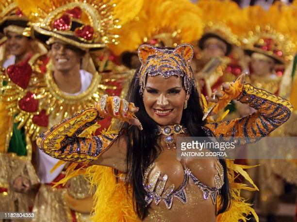 Elaine Ribeiro, Queen of the Drums of the Porto da Pedra samba school, performs ahead of the musicians 27 February, 2006 during the second night of...