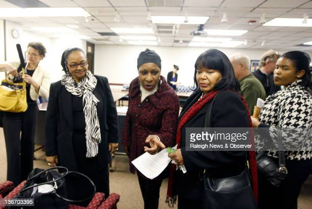 Elaine Riddick center speaks with Sadie Long not shown after the Eugenics Compensation Task Force announced their recommendation during a meeting on...