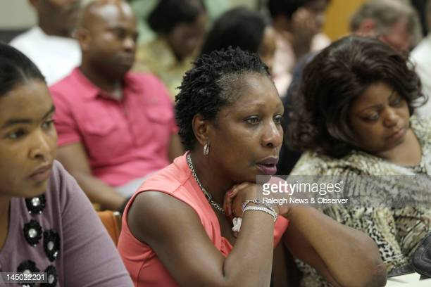 Elaine Riddick center weeps at a House committee meeting on Tuesday May 22 2012 The committee approved a bill to provide compensation for victims of...
