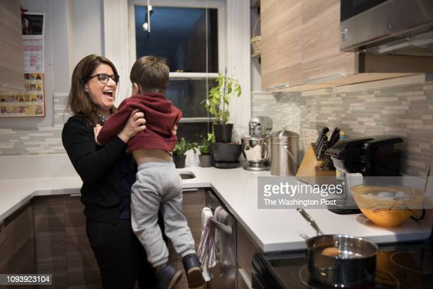 Elaine Rigas plays with her son in her condominium in Washington DC on February 1 2019 Rigas spent more than a year and $100000 in legal fees to...