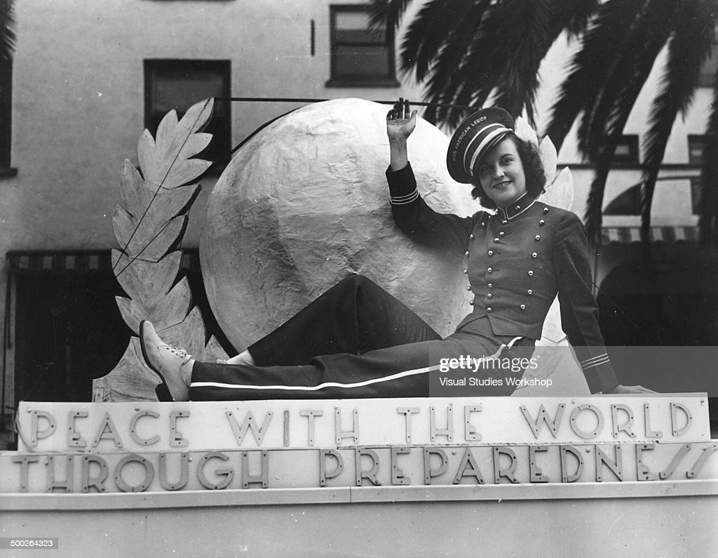 Elaine Russel, the 'Miss America' of the Legion aboard the Mississippi delegation's float, Los Angeles, California, 1938.