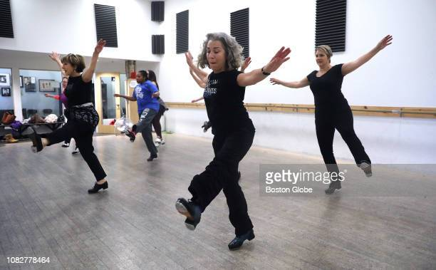 Elaine Shannon, center, kicks up her heels with the rest of the class as intermediate and advanced tap students take a 90-minute class with...