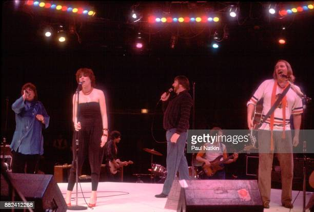 Elaine 'Spanky' McFarlane MacKenzie Phillips Denny Doherty and John Phillips of The New Mamas and Papas at The Mill Run Theater in Niles Illinois...