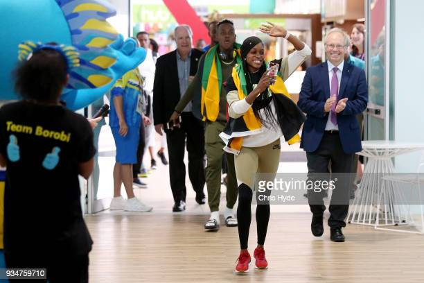 Elaine Thompson and Julian Forte of the Jamaican 2018 Commonwealth Games team arrive with Chairman Peter Beattie and CEO Mark Peters at the Gold...