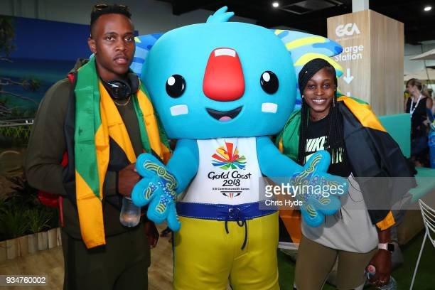 Elaine Thompson and Julian Forte of the Jamaican 2018 Commonwealth Games team pose with Borobi at the Gold Coast Airport on March 20, 2018 in Gold...