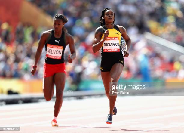 Elaine Thompson of Jamaica and Kai Selvon of Trinidad and Tobago compete in the Women's 200 metres heats during the Athletics on day six of the Gold...