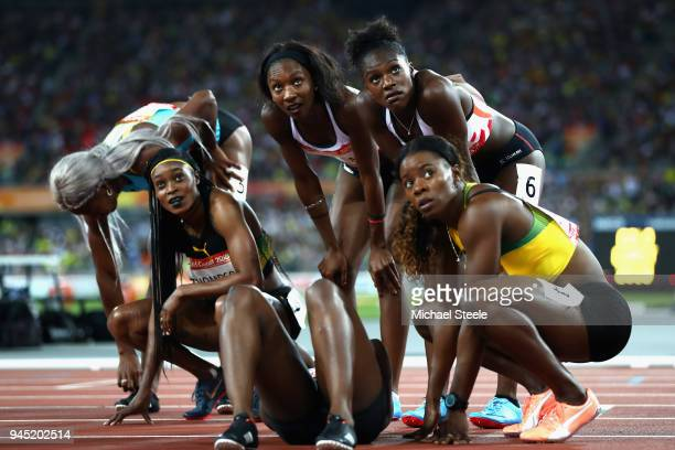 Elaine Thompson of Jamaica Bianca Williams of England Dina AsherSmith of England and Shericka Jackson of Jamaica look at the scoreboard after the...