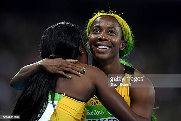 Elaine Thompson of Jamaica celebrates winning the Women's 100m Final with Shelly-Ann Fraser-Pryce of Jamaica on Day 8 of the Rio 2016 Olympic Games...