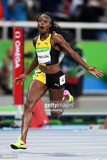 Elaine Thompson of Jamaica celebrates winning the Women's 100m Final on Day 8 of the Rio 2016 Olympic Games at the Olympic Stadium on August 13 2016...