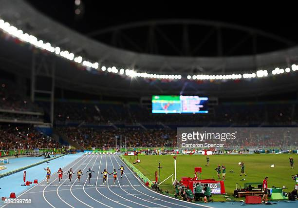 Elaine Thompson of Jamaica celebrates winning the Women's 100m Final ahead of Tori Bowie of the United States and Shelly-Ann Fraser-Pryce of Jamaica...