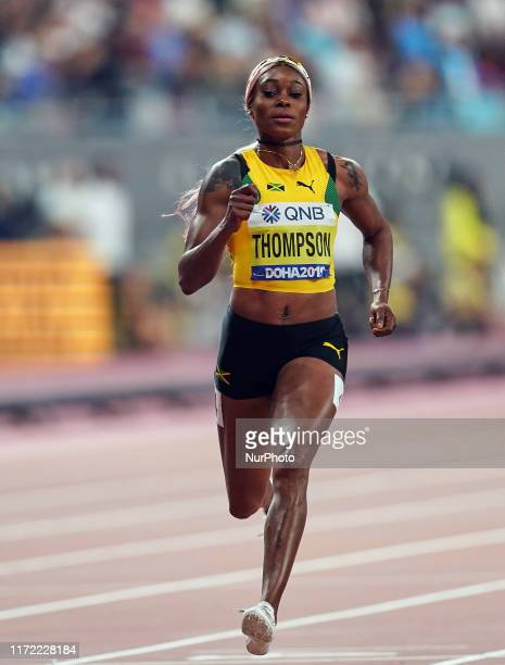 Elaine Thompson of Jamaica competing in the 100 meter for women during the 17th IAAF World Athletics Championships at the Khalifa Stadium in Doha,...