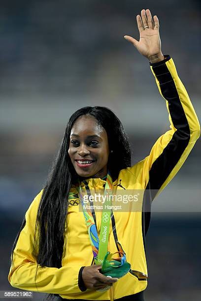 Elaine Thompson of Jamaica poses with the gold medal for Women's 100 meter on Day 9 of the Rio 2016 Olympic Games at the Olympic Stadium on August 14...