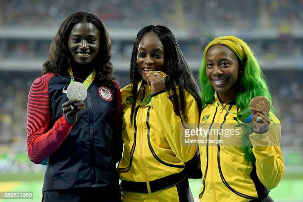 Elaine Thompson of Jamaica poses with the gold medal Tori Bowie of the United States, silver medal, and Shelly-Ann Fraser-Pryce of Jamaica, bronze...