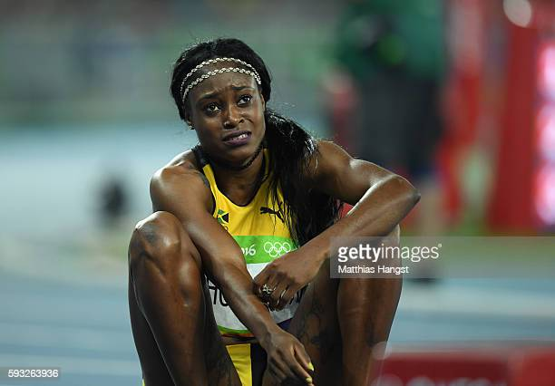 Elaine Thompson of Jamaica reacts after winning the gold medal in the Women's 200 metres final on Day 12 of the Rio 2016 Olympic Games at the Olympic...